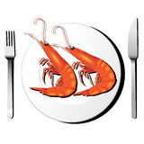 Shrimp on white dish with fork and knife  Royalty Free Stock Image