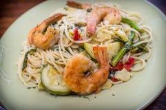 Shrimp White Wine Sauce. Shrimp spaghetti primavera with white wine sauce and green vegetables Royalty Free Stock Image
