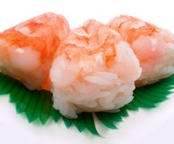 Shrimp (wide angle). Rice is topped with shrimp and is arranged together in a group of three. It is a perfect side to a Japanese sushi meal Royalty Free Stock Images