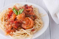 Shrimp in wine tomato sauce over spaghetti pasta Stock Photo