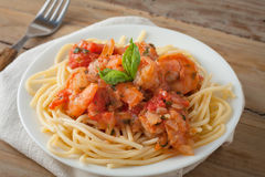 Shrimp in wine tomato sauce over spaghetti pasta Stock Photos