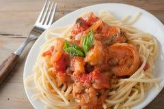 Shrimp in wine tomato sauce over spaghetti pasta Stock Image