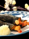 Shrimp wrapped in nori seaweed with grated ginger Stock Image
