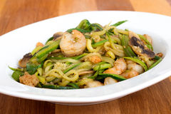 Shrimp with zucchini noodles stir-fry Royalty Free Stock Image