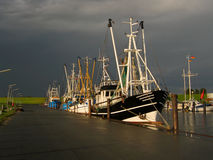 Shrimpboats in thunderstorm Royalty Free Stock Photos