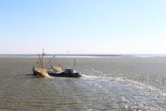 Shrimper Sails Over Dutch Waddensea, Ameland Stock Photo