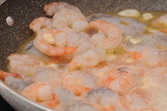 Shrimps 004. Frozen shrimps in a pan with boiling oil Stock Images