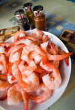 Shrimps. A plate of big (tiger) shrimps (prawns), with some spices in the background Royalty Free Stock Image