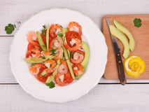 Shrimps, Avocado and Tomatoes Salad. On a white Royalty Free Stock Images