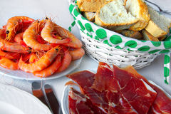 Shrimps and bacon Stock Images