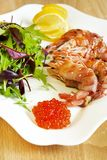 Shrimps baked in bacon with salad Royalty Free Stock Photo