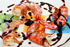 Shrimps with balsamic vinegar. A dish of tasty grilled shrimps with balsamic vinegar stock photos