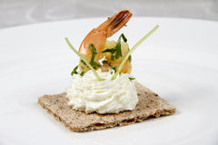 Shrimps on biscuit with cheese cream Stock Photography