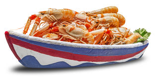 Shrimps in a bowl in the form of a ship Stock Photography