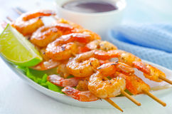 Shrimps. In the bowl and on a table stock photos