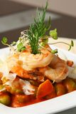 Shrimps with caper. Four shrimps with caper and artichoke on the table Royalty Free Stock Photo
