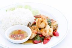 Shrimps with chili, basil, sunny-side-up, stream rice. Royalty Free Stock Photo