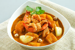 Shrimps in concentrated curry. Thai shrimps curry in concentrated gravy with potato and thai herbs stock photos