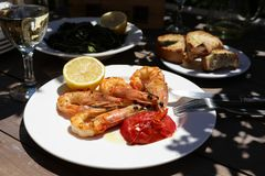 Shrimps cooked on grill in the greek tavern. royalty free stock photo
