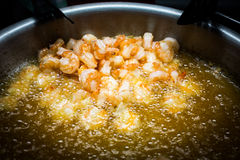 Shrimps cooking in oil Stock Image