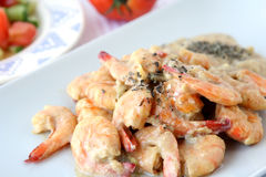 Shrimps dish with sauce Stock Images
