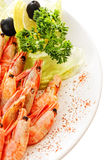 Shrimps dressed with greens and lemons Royalty Free Stock Photo