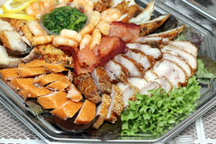 Shrimps, fish slices assortment on Party plate Stock Photo
