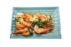 Shrimps fried with fresh herbs in dish Royalty Free Stock Photography