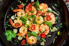 Shrimps fried on pan Stock Photo