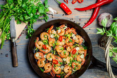 Shrimps fried on pan and fresh herbs Royalty Free Stock Images