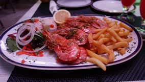 Shrimps with fries Stock Photo