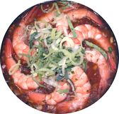 Shrimps on a frying pan about a leek Royalty Free Stock Photos