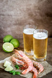 Shrimps with glasses of beer Stock Photo