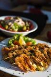 Shrimps and Greek salad, mediterranean cousine.  Royalty Free Stock Image