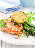 Shrimps with green asparagus Stock Photos