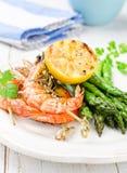 Shrimps with green asparagus Stock Photos