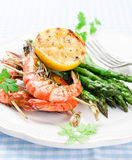 Shrimps with green asparagus Royalty Free Stock Photo