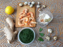 Shrimps in green nettles tempura, cooking vegetarian food. With nettles stock image