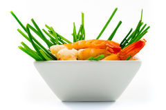 Shrimps and green onions in white cup. On white background Royalty Free Stock Images