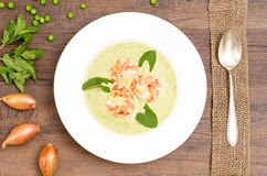 Shrimps in green pea soup Royalty Free Stock Images