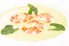 Shrimps with green soup of mint Royalty Free Stock Images