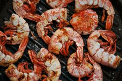 Shrimps on the grill with vintage wooden background Royalty Free Stock Photography