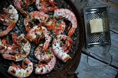 Shrimps on the grill with vintage wooden background Stock Images