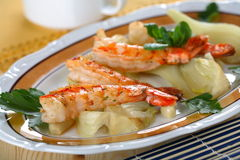 Shrimps with grilled onion Royalty Free Stock Image