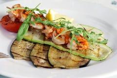Shrimps with grilled vegetables. Shrimps with grilled vegetables under arugula salad Stock Photo