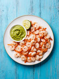 Shrimps with Guacamole on plate Stock Photo