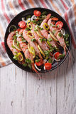 Shrimps with herbs and vegetables in a pan. vertical top view Stock Images