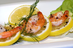 Shrimps on lemon Stock Photos