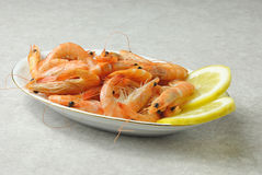 Shrimps with lemon Stock Images