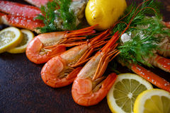 Shrimps with lemon on a background of crab meat closeup. Shrimps with lemon on a background of crab meat Royalty Free Stock Photos